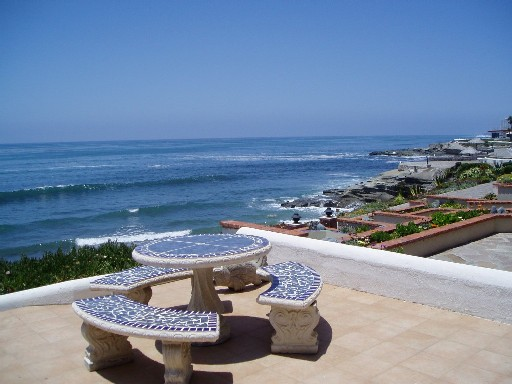 Large Outdoor Dining overlooking the Pacific Ocean and surfers surfing